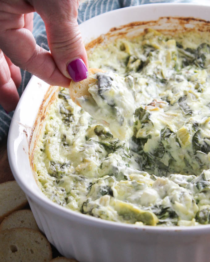 Creamy Spinach Dip - made with fresh spinach and cream cheese, this is a total crowd favorite! --bakedinaz.com
