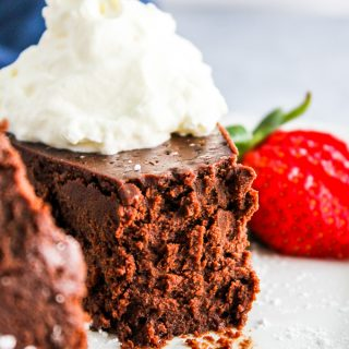 Flourless Chocolate Cake! My favorite cake ever! This fudge like creamy chocolate cake is gluten free too! So rich, creamy and delicious! via bakedinaz.com #cake #chocolate #flourlesscake #dessert #rich